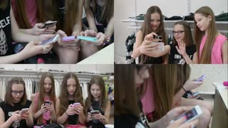 Girls Children with their Smartphones and mobile phone chating in clothes store