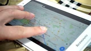 Google Maps On Digital Tablet - Man looking searching Berlin
