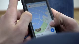 Google Maps On Mobile Cell Phone - Man looking searching Sydney Australia