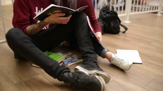 Guy and Girl Students lovers studying lectures write an Abstract read a Textbook