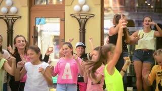 Happy Children dancing on the street near Ice Cream Shop