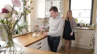 Happy Couple Family Man and Woman drink Morning Coffee at Kitchen