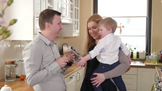 Happy Couple Family with little Boy Kid drink Morning Coffee at Kitchen