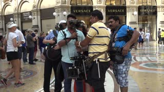 Indian movie team film in Milan - Operator with a Camera on the Steadicam