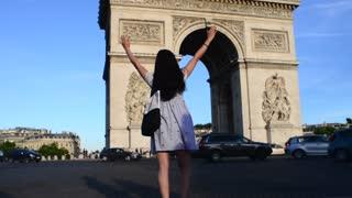 Korean girl photographed photo near the Arc de Triomphe in Paris - evening