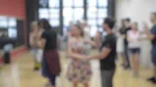 Latin Dancing At The Salsa School - teaching a new Movement