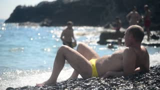 Liguria Italy sea Shore Beach and Rocks - Man sunbathe, relax and Swim