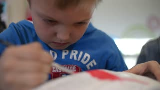 Little Boy Painting And Drawing a Doll Car With Acrylic Colors - Art Therapy