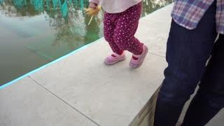Little child Stroller walk Legs with Mother