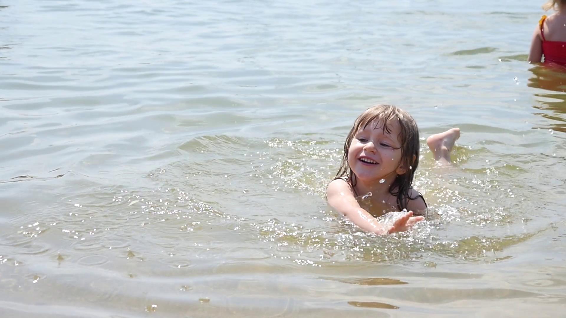 Little Girl Swimming In Lake Stock Image - Image of aqua