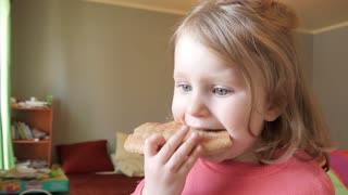 Little Girl Kid eating a Pie at Home