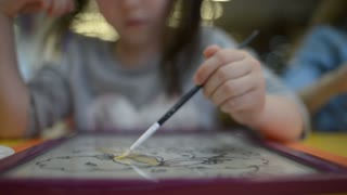 Little Girl Painting And Drawing different Colors - Art Therapy