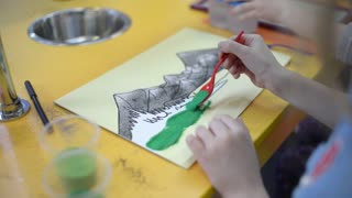 Little Girl Painting And Drawing Mountains with colorful Sand - Art Therapy