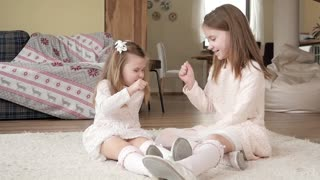 Little girls Kids play a Hand Game rock-paper-scissors at Home having fun