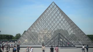 Louvre Museum In Paris France With Crowds Of People At Glass Pyramid