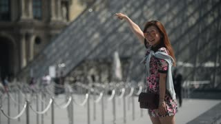 Louvre Museum In Paris France With korean girl photographing At Glass Pyramid
