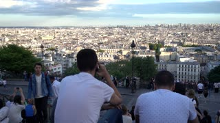 Majestic Panorama of Paris people relax and look from Montmartre hill