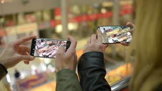Man and Woman together make Photo with Smart Phone - Odessa Mall