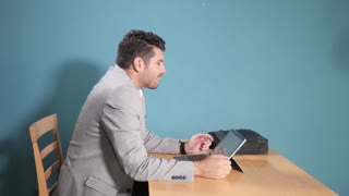 Man hurts his neck from working with Laptop Netbook