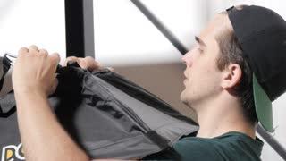 Man Photographer preparing Light system in Photo Studio