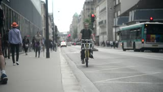 Man ride Bicycle on the Street of City Paris