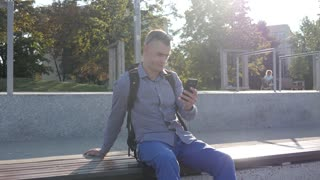 Man Tourist use Mobile Smart Phone browse internet - traveling Europe Poland