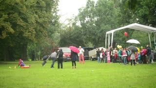 Many People have fun Sleighs in rainy Park on Family Festival - Wroclaw, Poland