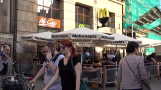 McDonalds Restaurant people eating at the Tables on Street - Wroclaw Poland