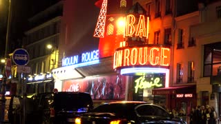 Moulin Rouge cabaret at night neon lights on the Boulevard de Clichy in Paris
