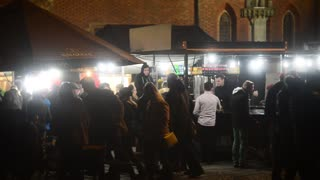 Night life in the City - many People on a Market Square on New Year Celebration