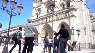 Notre-Dame de Paris cathedral and crowd of people tourists in Summer Day