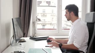 Office Man working with Computer pc, white Shirt, bright Office