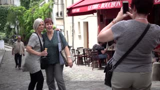 Old ladies make photo on a street Montmartre Paris