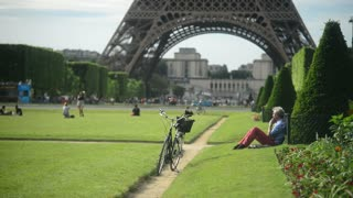 Old Man relaxing sitting with his Bicycle on Grass Champs-de-Mars Paris