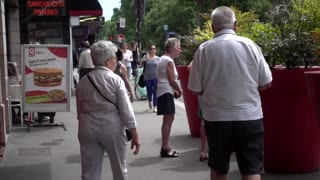 Old People tourists near cabaret entrance on Boulevard de Clichy in Paris