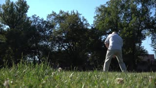 Old Senior Business Man with white Beard Playing Golf