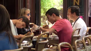 Paris Latin Quarter - people eating at the tables cozy modest cafe restaurant