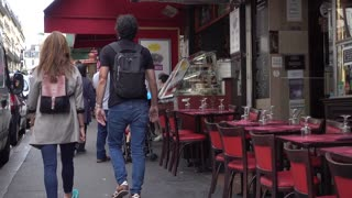 Pedestrian walk by the Tables of Street Cafe - Montmartre Paris