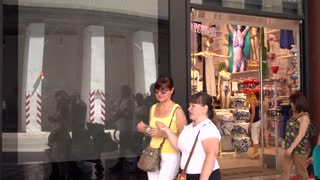 Pedestrian walk through Shopping Gallery with many Stores of Milan Italy