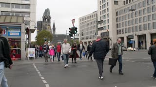Pedestrians cross the Street in Centre of Berlin, Germany - autumn day