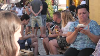 People Family eateng on a Street Food Festival in Poland