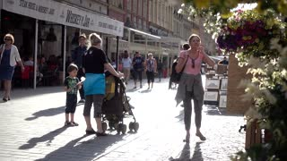 People pedestrian walking street in old european city Wroclaw Breslau Poland - summer day