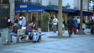 People walk along Champs Elysees Bistro and Restaurant in Paris