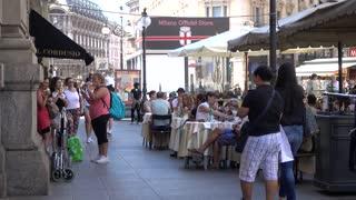 People walking and sitting eat Stree Food Cafe - Milan, Italy