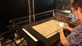 Photo scanning and digitizing laboratory of an old Manuscript and Newspaper