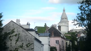 Place Dalida Montmartre in summer Paris - roofs of an old buildings