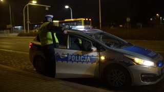 Police Car on a Road with flashing Lightning - Wroclaw, Poland