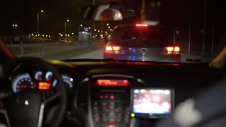 Police stop the Car on a Pursuit on a Road with flashing Lightning