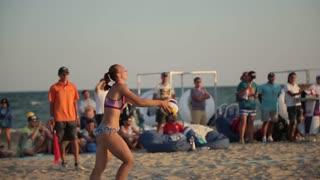 Sportive Girls Play Beach volleyball at Summer