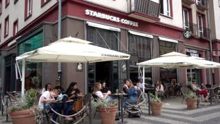 Starbucks Coffee Restaurant people sitting drink at the Tables - Wroclaw Poland
